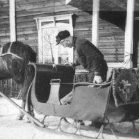 Isäntä ja hevonen rekineen
